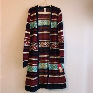 Girls long sweater, cute with jeans, never worn.